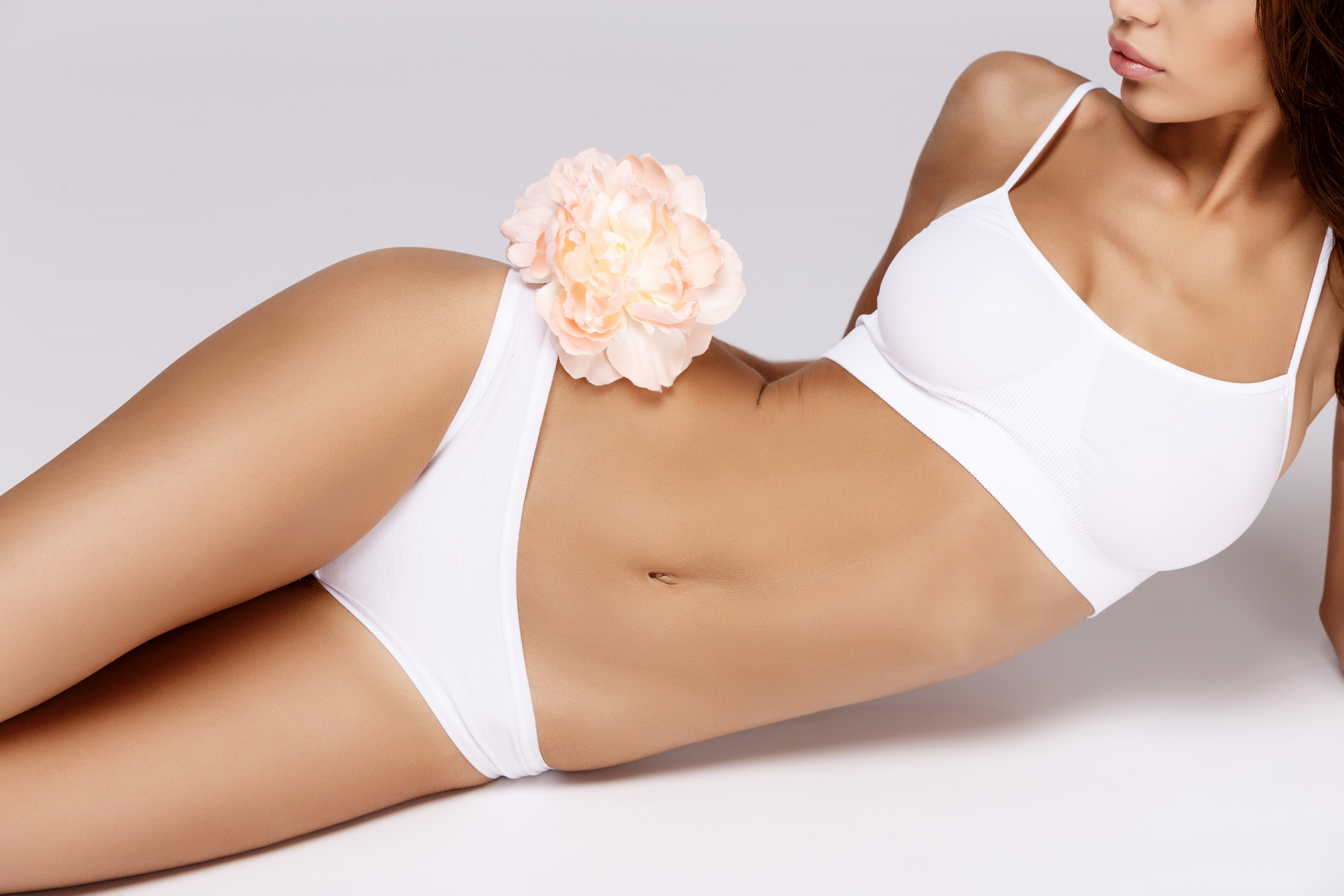 Tummy Tuck and Breast Implants Package Deal + 14 Nights